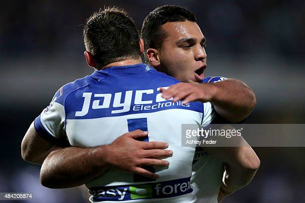 Brett Morris of the Bulldogs celebrates a try during with team mate the round 23 NRL match between the Canterbury Bulldogs and the Gold Coast Titans...