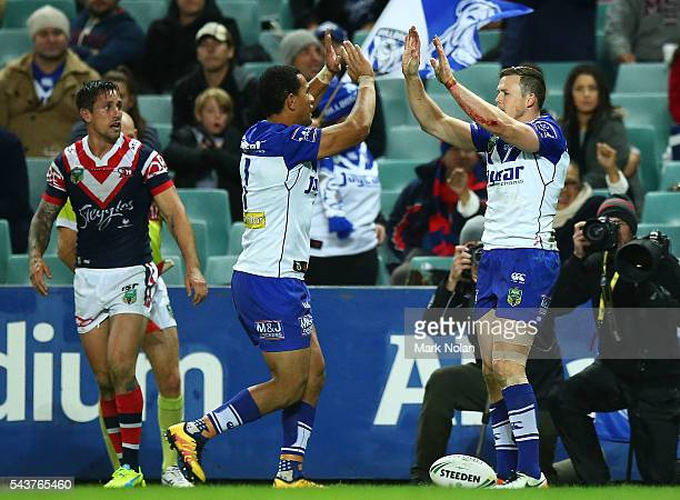 Brett Morris of the Bulldogs celebrates scoring a try during the round 17 NRL match between the Sydney Roosters and the Canterbury Bulldogs at...