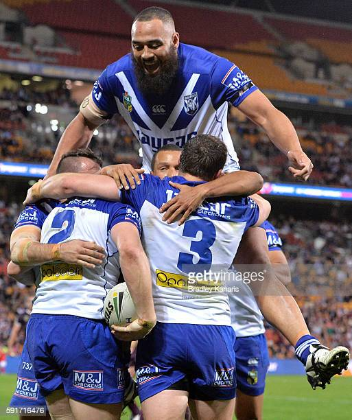 Brett Morris of the Bulldogs is congratulated by team mates after scoring a try during the round 24 NRL match between the Brisbane Broncos and the...