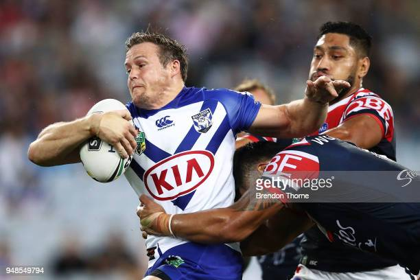 Brett Morris of the Bulldogs is tackled by Roosters defence during the round seven NRL match between the Canterbury Bulldogs and the Sydney Roosters...