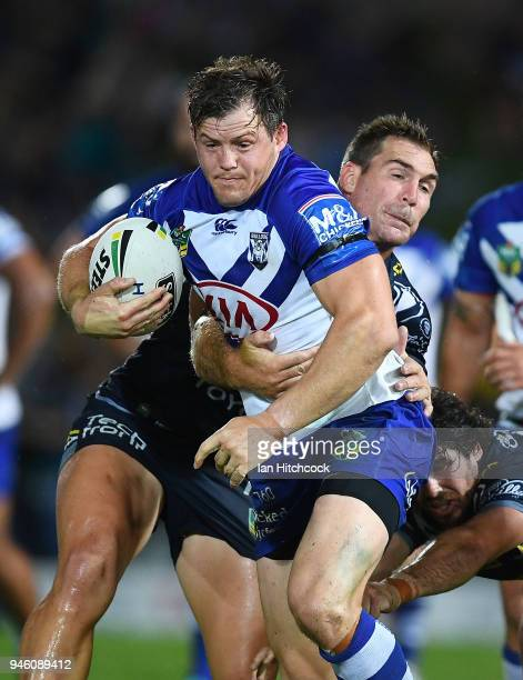Brett Morris of the Bulldogs is tackled by Scott Bolton of the Cowboys during the round six NRL match between the North Queensland Cowboys and the...
