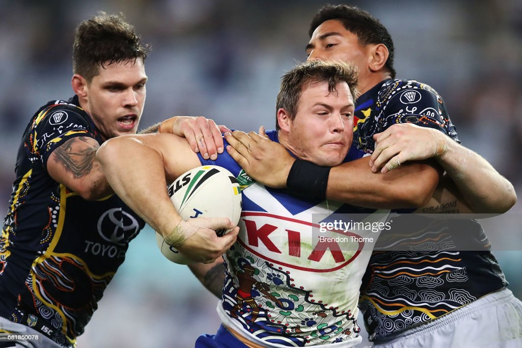 Brett Morris of the Bulldogs is tackled by the Cowboys defence during the round 10 NRL match between the Canterbury Bulldogs and the North Queensland Cowboys at ANZ Stadium on May 11, 2017 in Sydney, Australia.
