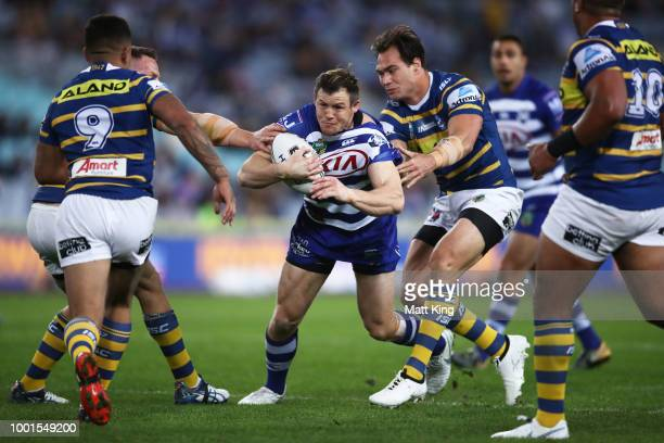 Brett Morris of the Bulldogs is tackled during the round 19 NRL match between the Parramatta Eels and the Canterbury Bulldogs at ANZ Stadium on July...
