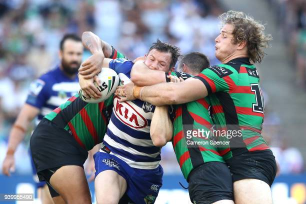Brett Morris of the Bulldogs is tackled during the round four AFL match between the South Sydney Rabbitohs and the Canterbury Bulldogs at ANZ Stadium...