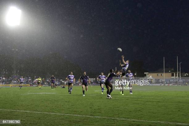 Brett Morris of the Bulldogs jumps to take a kick during the round one NRL match between the Canterbury Bulldogs and the Melbourne Storm at Belmore...