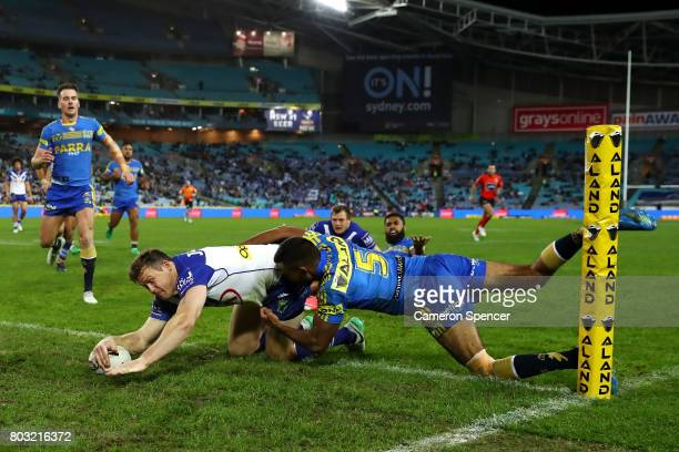 Brett Morris of the Bulldogs scores a try during the round 17 NRL match between the Parramatta Eels and the Canterbury Bulldogs at ANZ Stadium on...