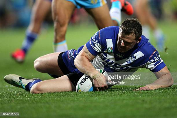 Brett Morris of the Bulldogs scores a try during the round 23 NRL match between the Canterbury Bulldogs and the Gold Coast Titans at Central Coast...