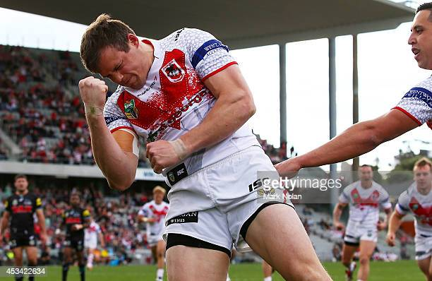 Brett Morris of the Dragons celebrates scoring a try during the round 22 NRL match between the St George Dragons and the Penrith Panthers at WIN...