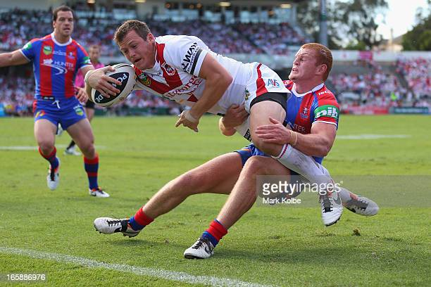 Brett Morris of the Dragons dives over to score a try during the round five NRL match between the St George Illawarra Dragons and the Newcastle...