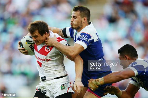 Brett Morris of the Dragons is tackled by Josh Reynolds of the Bulldogs during the round nine NRL match between the St George Illawarra Dragons and...