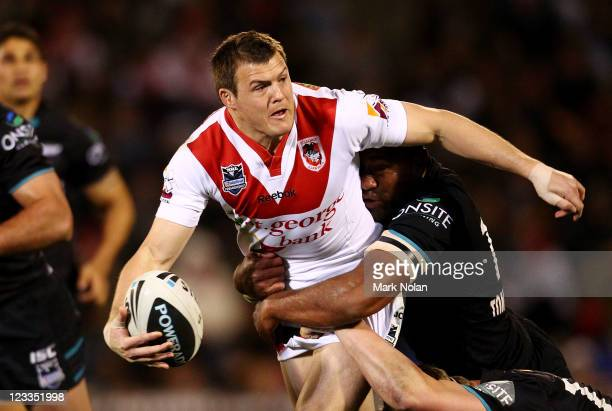 Brett Morris of the Dragons looks for support during the round 26 NRL match between the St George Illawarra Dragons and the Penrith Panthers at WIN...