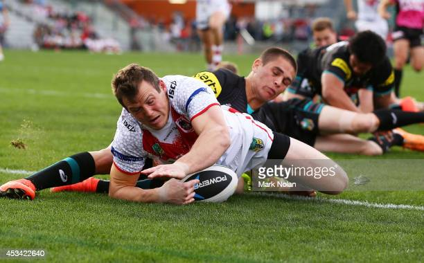 Brett Morris of the Dragons scores a try a try during the round 22 NRL match between the St George Dragons and the Penrith Panthers at WIN Stadium on...