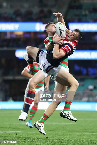Brett Morris of the Roosters and Adam Doueihi of the Rabbitohs compete for the ball in the air during the NRL Qualifying Final match between the...