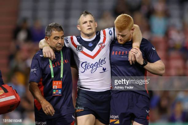 Brett Morris of the Roosters comes off injured during the round eight NRL match between the Newcastle Knights and the Sydney Roosters at McDonald...