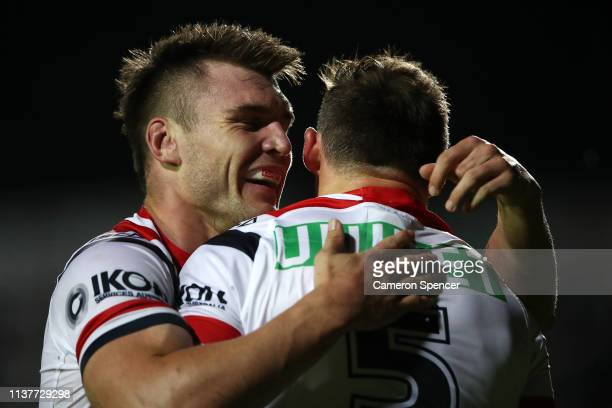 Brett Morris of the Roosters is congratulated by team mate Angus Crichton of the Roosters after scoring a try during the round two NRL match between...