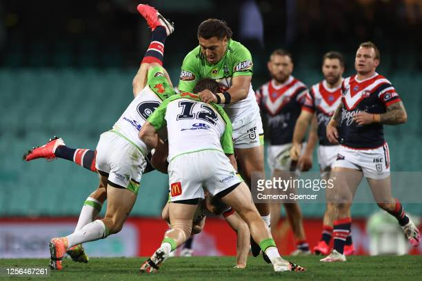Brett Morris of the Roosters is dumped onto his head during the round 10 NRL match between the Sydney Roosters and the Canberra Raiders at the Sydney...