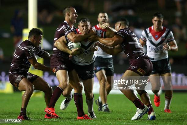 Brett Morris of the Roosters is tackled during the round two NRL match between the Manly Sea Eagles and the Sydney Roosters at Lottoland on March 23...