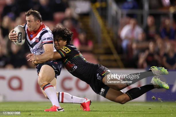 Brett Morris of the Roosters is tackled Jarome Luai of the Panthers during the NRL Qualifying Final match between the Penrith Panthers and the Sydney...