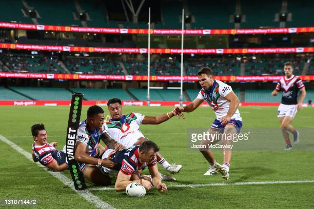 Brett Morris of the Roosters scores a try during the round four NRL match between the Sydney Roosters and the New Zealand Warriors at Sydney Cricket...