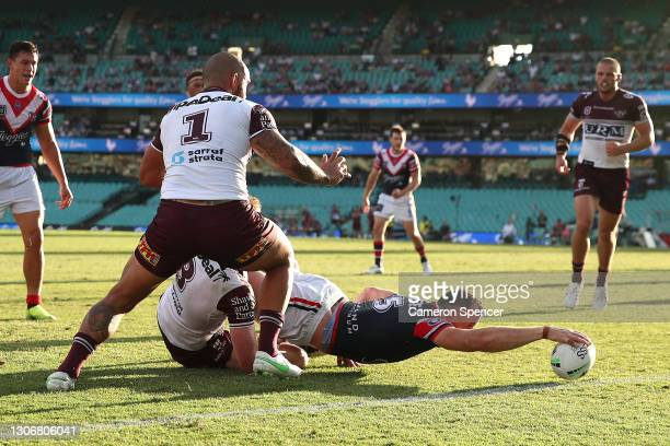 Brett Morris of the Roosters scores a try during the round one NRL match between the Sydney Roosters and the Manly Sea Eagles at the Sydney Cricket...