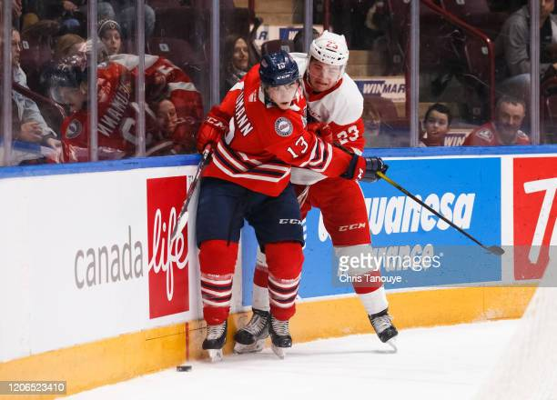 Brett Neumann of the Oshawa Generals battles for the puck with Rory Kerins of the Sault Ste. Marie Greyhounds during an OHL game at the Tribute...