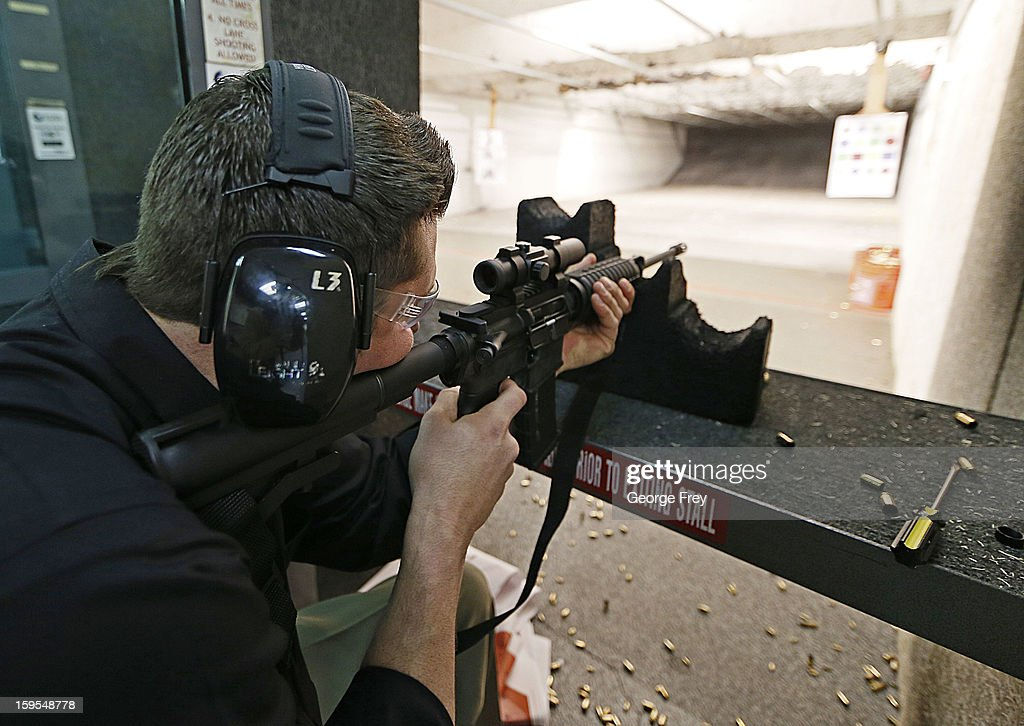 Firearms Enthusiasts Practice Shooting At Gun Range