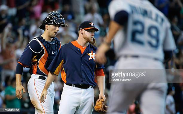 Brett Oberholtzer and Jason Castro of the Houston Astros celebrate at the mound after Oberholtzer threw a complete game shutout as the Astros...