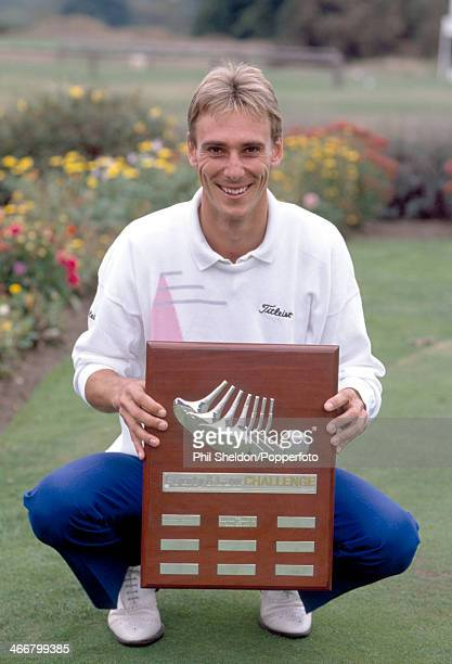 Brett Ogle of Australia holds the trophy after winning the Equity and Law Golf Tournament held at the Royal Mid Surrey Golf Club in Richmond circa...