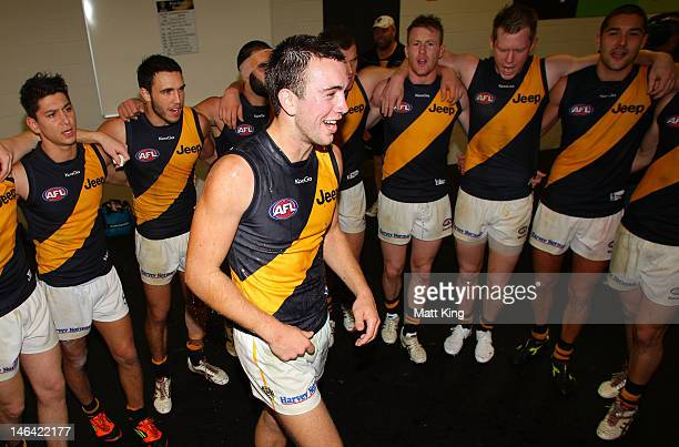 Brett O'Hanlon of the Tigers sings the team song with team mates after the round 12 AFL match between the Greater Western Sydney Giants and the...