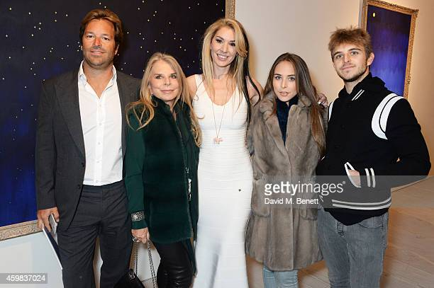 Brett Palos Lady Tina Green Stasha Palos Chloe Green and Brandon Green attend a private view of 'And The Stars Shine Down' by Stasha Palos at the...
