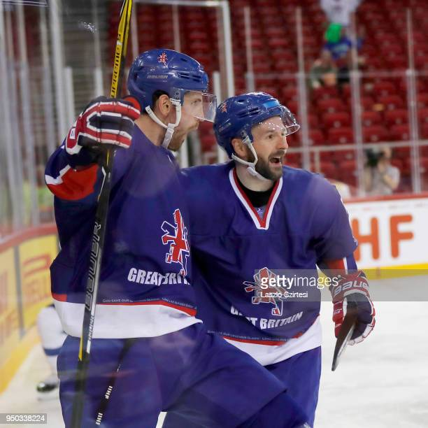 Brett Perlini of Great Britain celebrates his goal with Robert Dowd of Great Britain during the 2018 IIHF Ice Hockey World Championship Division I...