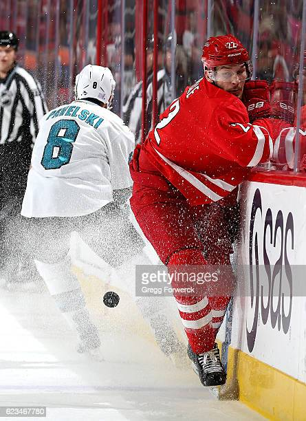 Brett Pesce of the Carolina Hurricanes and Joe Pavelski of the San Jose Sharks collide along the boards during an NHL game on November 15 2016 at PNC...