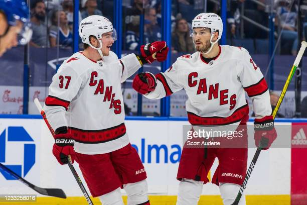 Brett Pesce of the Carolina Hurricanes celebrates a goal with teammate Andrei Svechnikov against the Tampa Bay Lightning during the second period in...