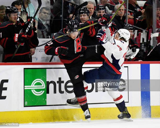 Brett Pesce of the Carolina Hurricanes checks TJ Oshie of the Washington Capitals during the second period in Game Three of the Eastern Conference...