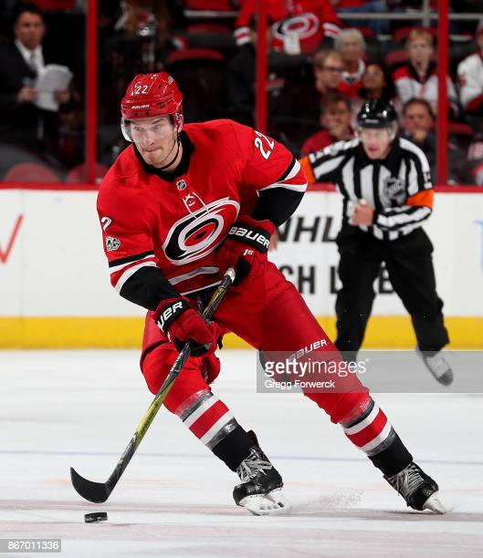 Brett Pesce of the Carolina Hurricanes controls a puck on the ice during an NHL game against the Tampa Bay Lightning on October 24 2017 at PNC Arena...