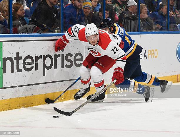 Brett Pesce of the Carolina Hurricanes handles the puck past Jaden Schwartz of the St Louis Blues on January 5 2017 at Scottrade Center in St Louis...