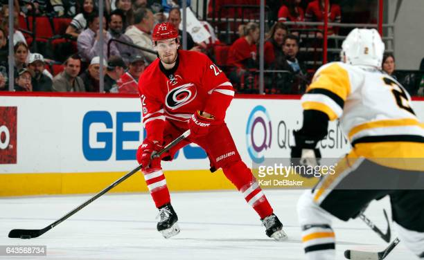Brett Pesce of the Carolina Hurricanes looks for a route to pass the puck by Chad Ruhwedel of the Pittsburgh Penguins during an NHL game on February...
