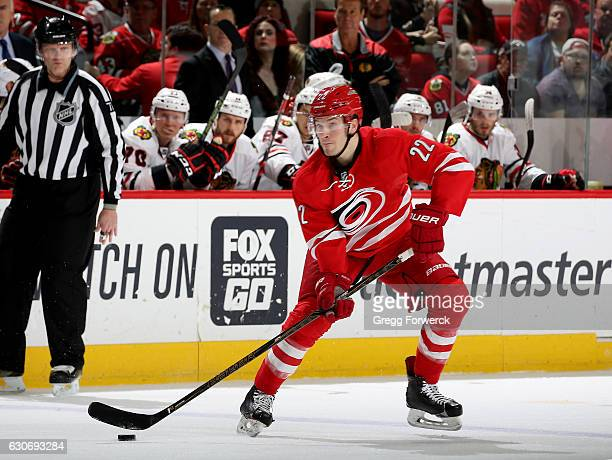 Brett Pesce of the Carolina Hurricanes looks to make a pass during an NHL game against the Chicago Blackhawks on December 30 2016 at PNC Arena in...