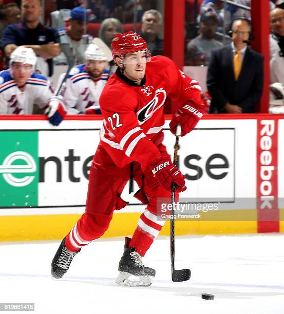 Brett Pesce of the Carolina Hurricanes looks to pass the puck during an NHL game against the New York Rangers on October 28 2016 at PNC Arena in...