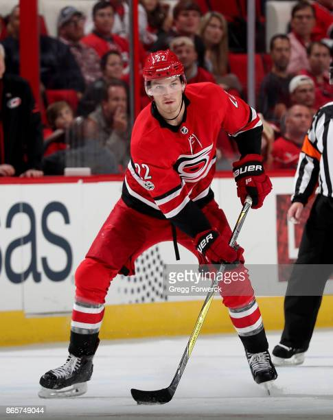 Brett Pesce of the Carolina Hurricanes looks to pass the puck during an NHL game against the Columbus Blue Jackets on October 10 2017 at PNC Arena in...