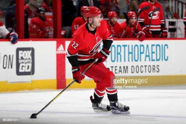 Brett Pesce of the Carolina Hurricanes moves the puck during an NHL game against the Montreal Canadiens on December 27 2017 at PNC Arena in Raleigh...
