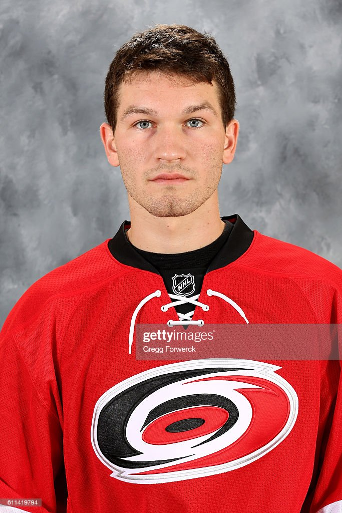 Brett Pesce #22 of the Carolina Hurricanes poses for his official headshot for the 2016-2017 season on September 22, 2016 at Carolina Family Practice and Sports Medicine in Raleigh, North Carolina.