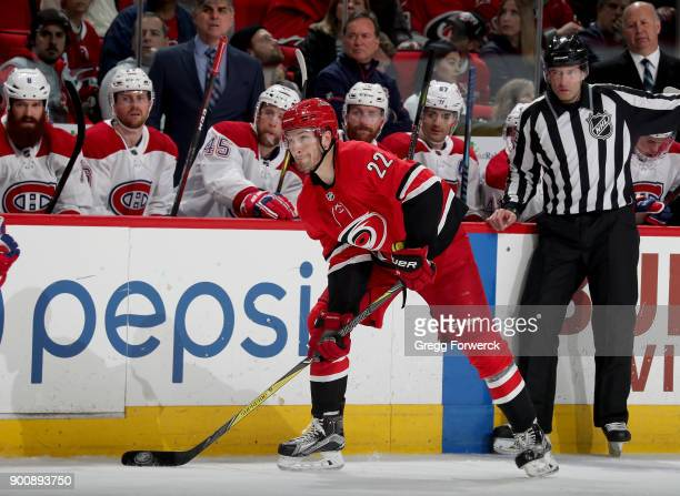 Brett Pesce of the Carolina Hurricanes prepares to pass the puck during an NHL game Montreal Canadiens on December 27 2017 at PNC Arena in Raleigh...