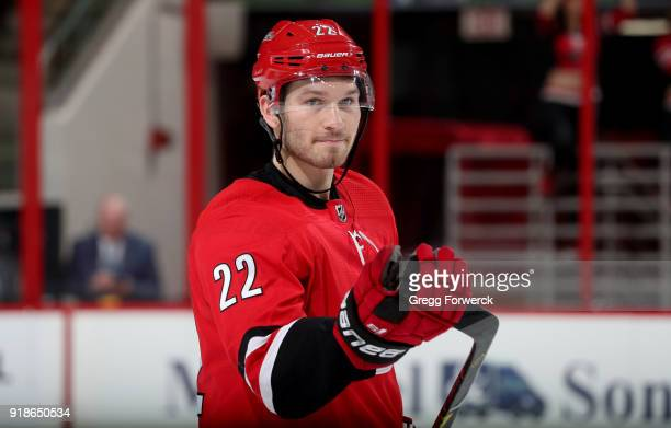 Brett Pesce of the Carolina Hurricanes skates back to the bench during a time out during an NHL game against the Colorado Avalanche on February 10...