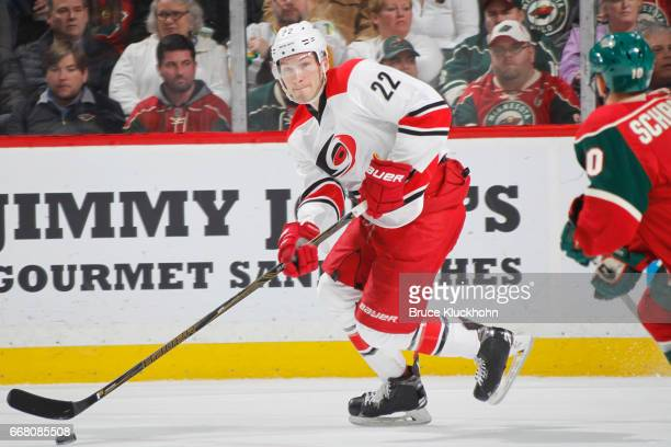 Brett Pesce of the Carolina Hurricanes skates with the puck against the Minnesota Wild during the game on April 4 2017 at the Xcel Energy Center in...