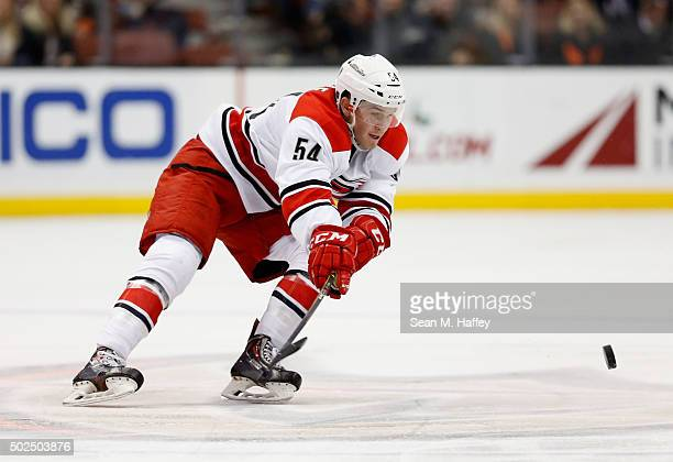 Brett Pesce of the Carolina Hurricanes skates with the puck during a game against the Anaheim Ducks at Honda Center on December 11 2015 in Anaheim...