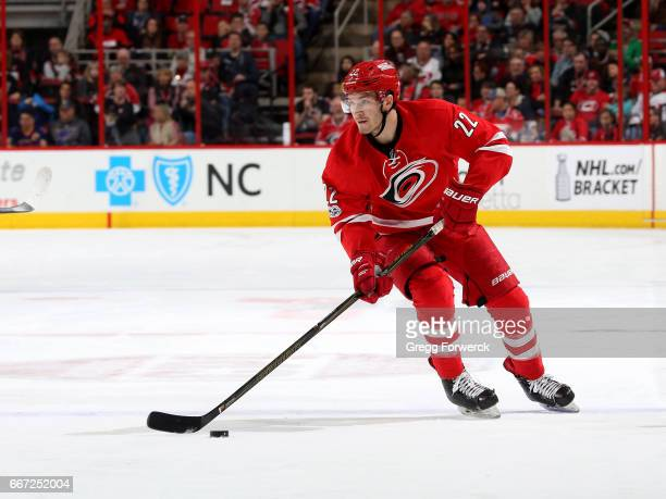Brett Pesce of the Carolina Hurricanes skates with the puck during an NHL game against the St Louis Blues on April 8 2017 at PNC Arena in Raleigh...