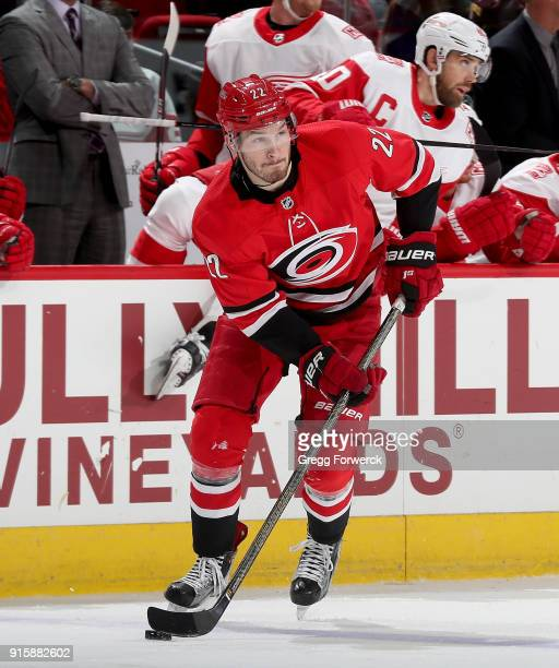 Brett Pesce of the Carolina Hurricanes skates with the puck during an NHL game against the Detroit Red Wings on February 2 2018 at PNC Arena in...