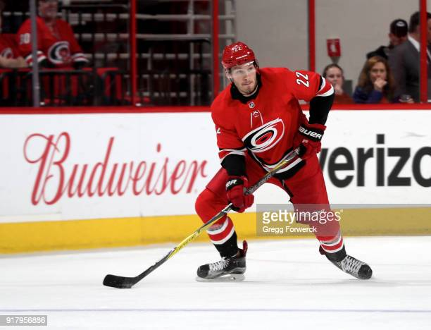 Brett Pesce of the Carolina Hurricanes skates with the puck during an NHL game against the Los Angeles Kings on February 13 2018 at PNC Arena in...