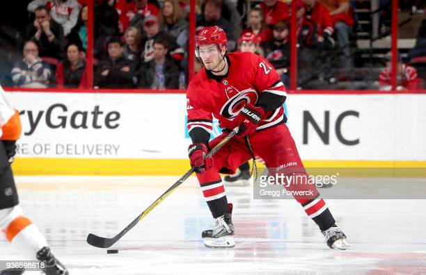 Brett Pesce of the Carolina Hurricanes skates with the puck during an NHL game against the Philadelphia Flyers on March 17 2018 at PNC Arena in...